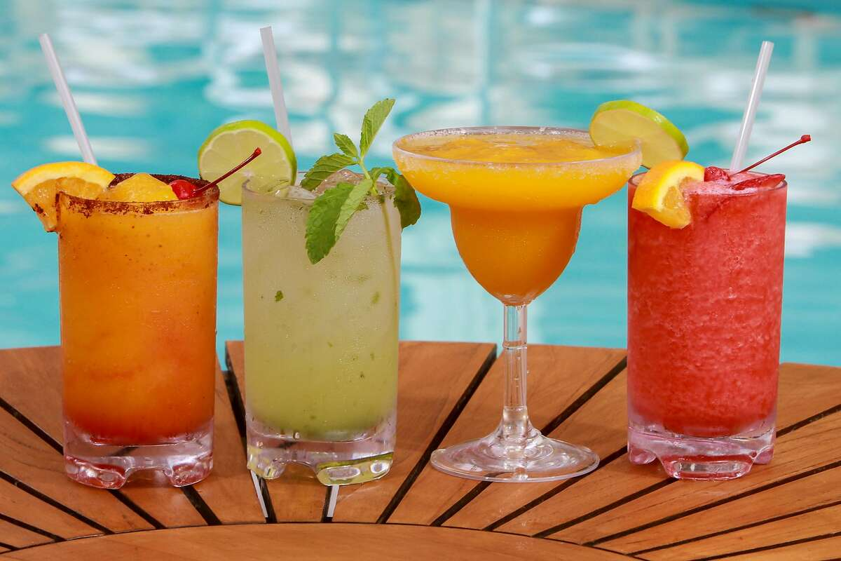 Starboard Sunset, from left, Mojito, Mango Margarita and Strawberry Daiquiri, on the pool deck at The Four Seasons Hotel. (For the Chronicle/Gary Fountain, May 31, 2016)