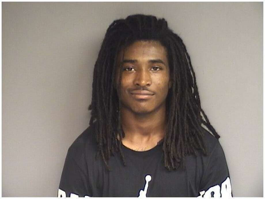Travis Vanterpool, 22, of Stamford, was charged with illegal possession of a pistol and possession of narcotics with intent to sell. Photo: Stamford Police / Contributed