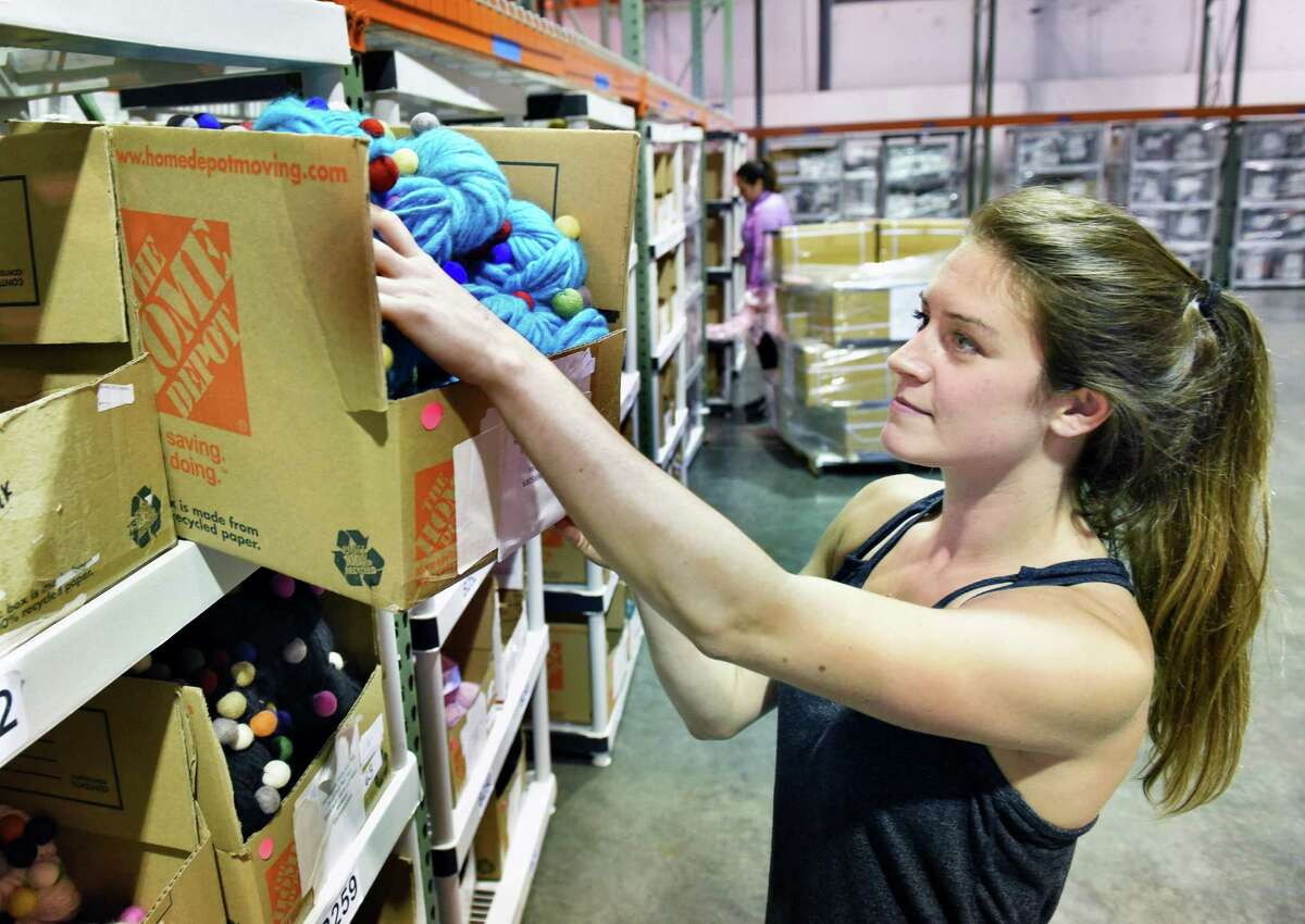 Darn Good Yarn operations manager Amanda Schermerhorn stocks felt ball yarn in their new 10,000 sq. ft. warehouse in Halfmoon Wednesday July 25, 2018 in Halfmoon, NY. (John Carl D'Annibale/Times Union)