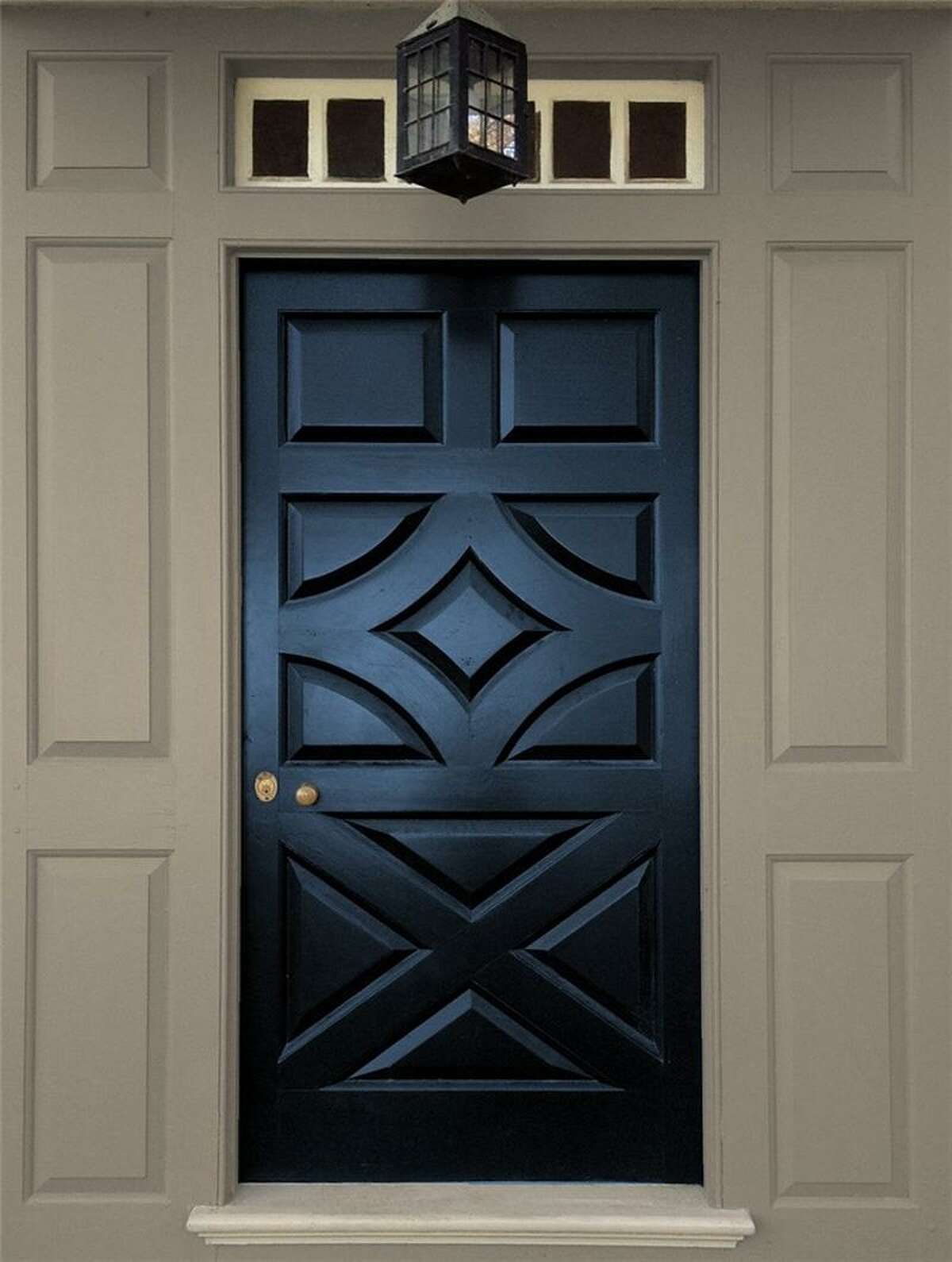 Benjamin Moore's North Sea Blue is trimmed with Iron Gate 1545.