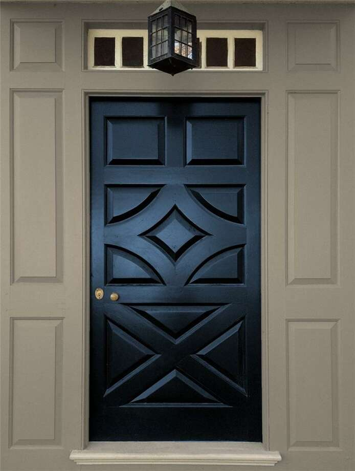 Benjamin Moore's North Sea Blue is trimmed with Iron Gate 1545. Photo: Contributed Photo