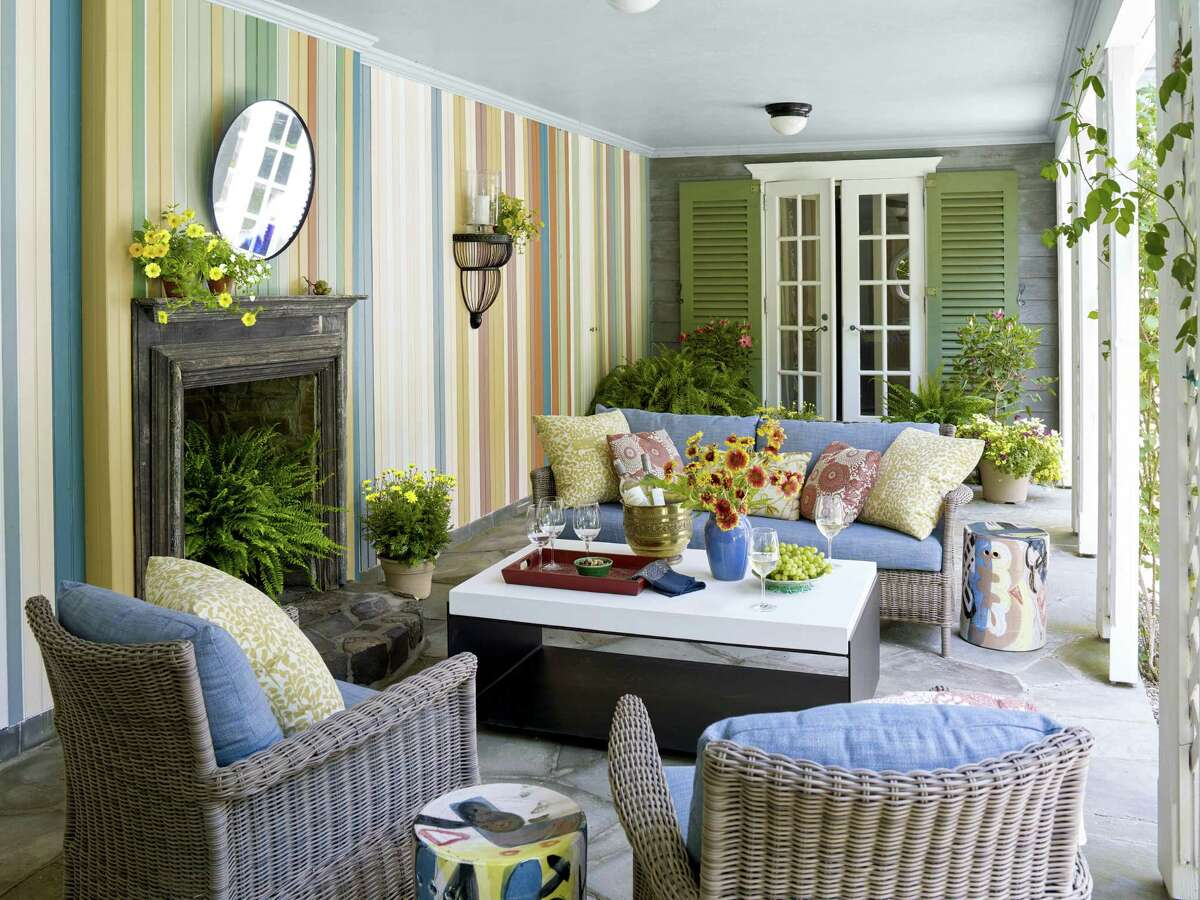 A porch designed Thomas Jayne plays fearlessly with color.