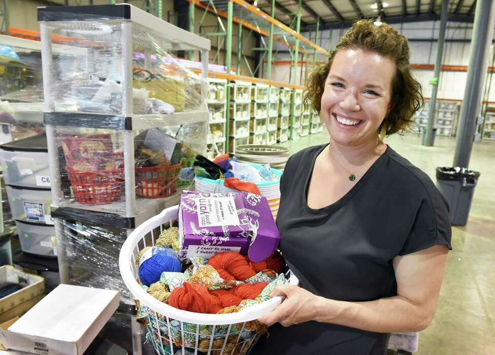 Nicole Snow, owner of Darn Good Yarn, one of the Capital Region's fastest-growing companies, stocks merchandise in their new 10,000 sq. ft. warehouse in Halfmoon Wednesday July 25, 2018 in Halfmoon, NY. (John Carl D'Annibale/Times Union)