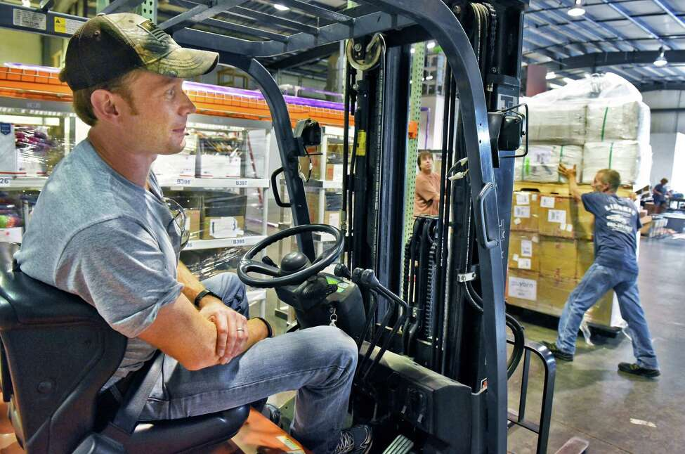 Mike Snow, who's wife Nicole owns Darn Good Yarn, one of the Capital Region's fastest-growing companies, oversees stocking merchandise in their new 10,000 sq. ft. warehouse in Halfmoon Wednesday July 25, 2018 in Halfmoon, NY. (John Carl D'Annibale/Times Union)
