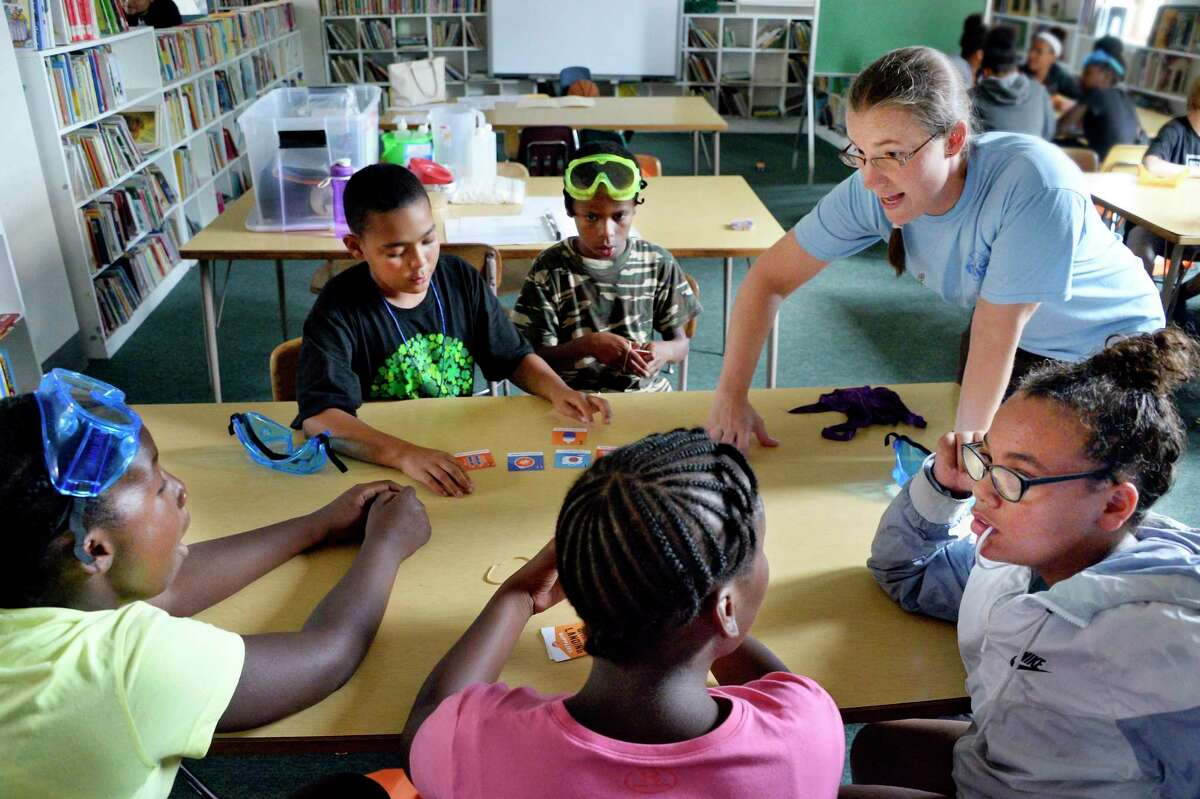 Alison DuBray,right, a miSci educator, works with children in the GSK Science in the Summer program at Pleasant Valley Elementary School Tuesday July 24, 2018 in Schenectady, NY. (John Carl D'Annibale/Times Union)