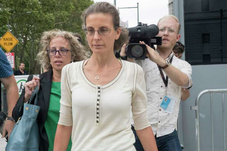 Clare Bronfman, center, leaves Federal court with her attorney Susan Necheles, left, Wednesday, July 25, 2018, in the Brooklyn borough of New York. Photo: Mary Altaffer, AP / Copyright 2018 The Associated Press. All rights reserved.
