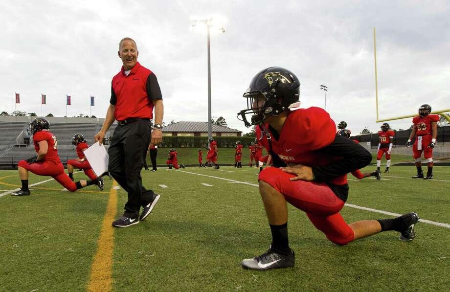 Caney Creek head coach Steve Svendsen jokes with quarterback Julian Hernandez before the Kingwood Park game last season. Photo: Jason Fochtman, Staff Photographer / Houston Chronicle / © 2017 Houston Chronicle