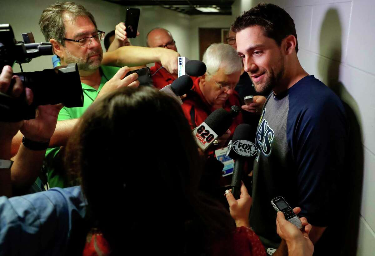Nathan Eovaldi speaks to the press after being traded from the Tampa Bay Rays to the Boston Red Sox prior a baseball game against the New York Yankees Wednesday, July 25, 2018, in St. Petersburg, Fla. (AP Photo/Mike Carlson)
