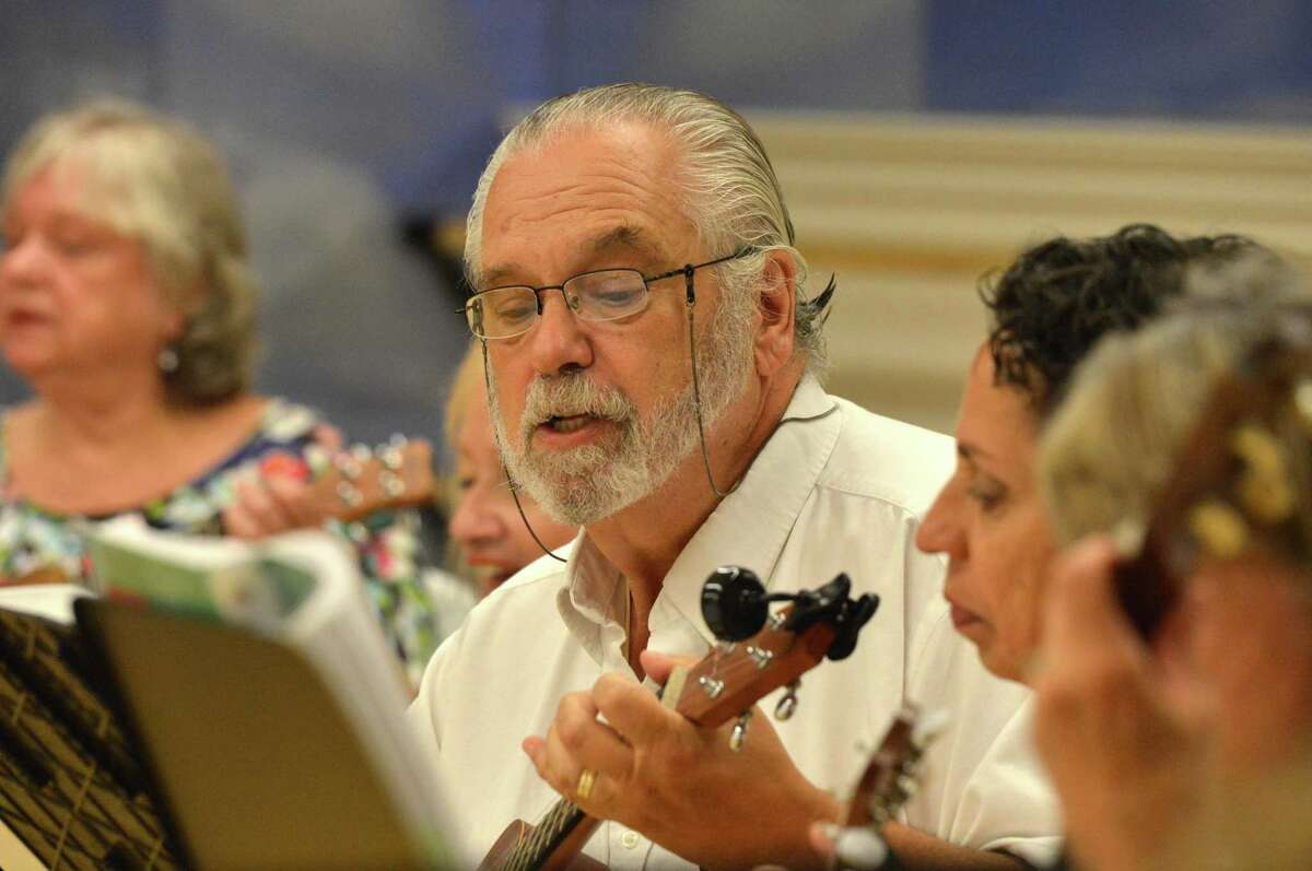 "Herm Freeman plays and sings along to ""Sloop John B."" during the weekly ukulele class at the Westport YMCA."