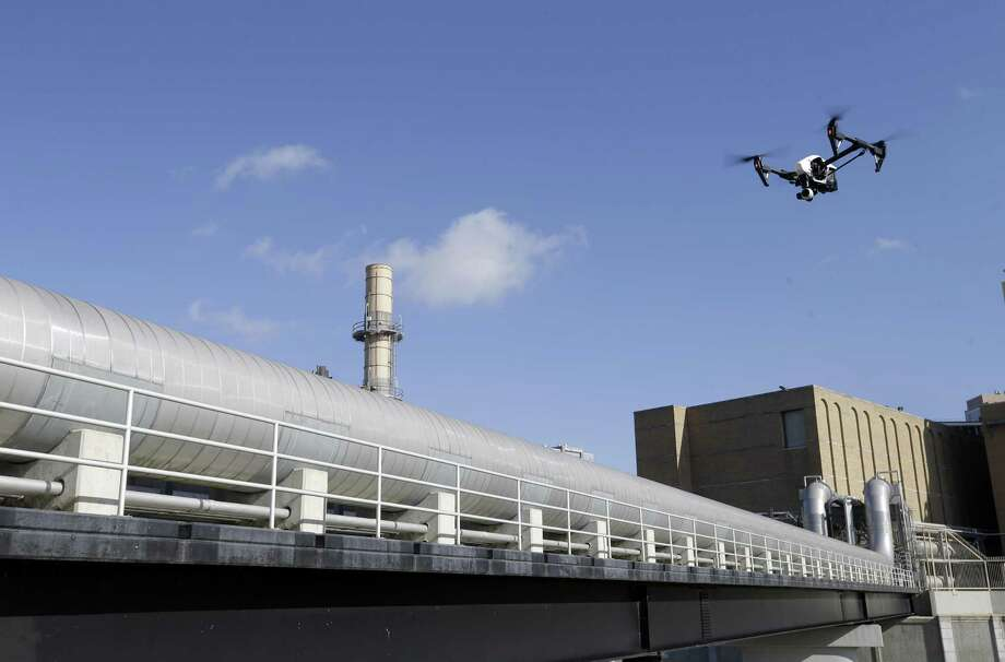 A multirotor drone is used by Arch Aerial for a flight over a pipe rack at Thermal Energy Corporation, 1615 Braeswood Blvd., Tuesday, June 26, 2018, in Houston.  ( Melissa Phillip / Houston Chronicle ) Photo: Melissa Phillip, Staff / Houston Chronicle / © 2018 Houston Chronicle