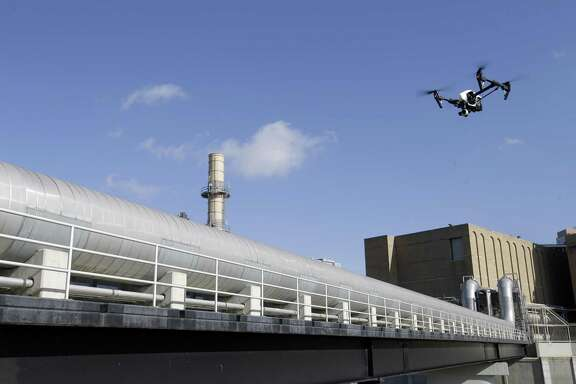 A multirotor drone is used by Arch Aerial for a flight over a pipe rack at Thermal Energy Corporation, 1615 Braeswood Blvd., Tuesday, June 26, 2018, in Houston.  ( Melissa Phillip / Houston Chronicle )
