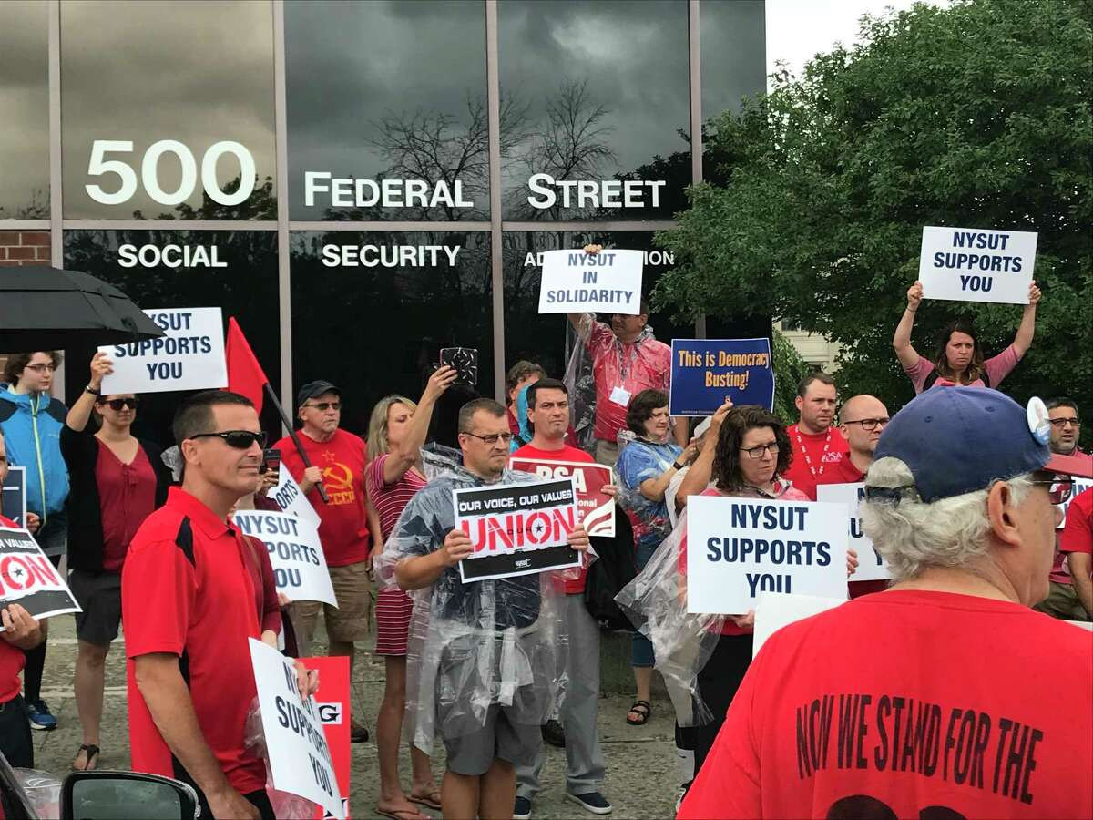 Union members rally outside the Social Security Administration office in Troy, NY in support of Adam Pelletier, who is on unexplained paid administrative leave from SSAon Wednesday July 25, 2018.