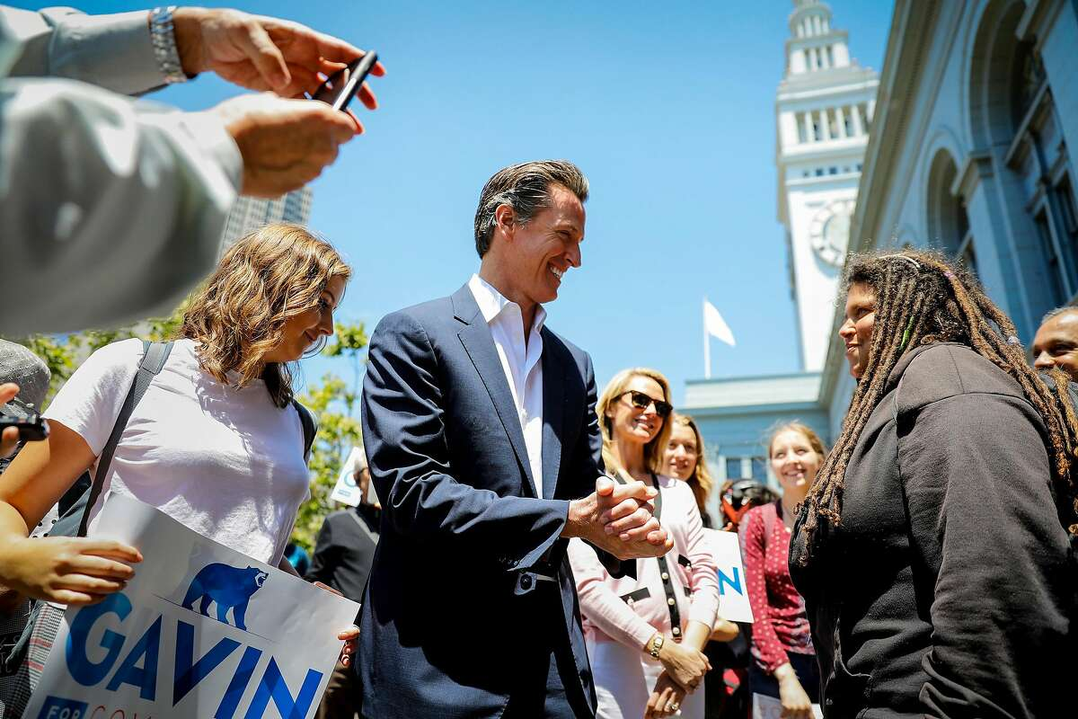 California Democratic candidate for governor, Lt. Gov Gavin Newsom, joined by his wife Jennifer Siebel Newsom, talks to supporters outside the Ferry Building and Marketplace in San Francisco on June 6, 2018. (Jay L. Clendenin/Los Angeles Times/TNS)