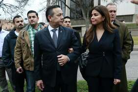 Former Texas State Sen. Carlos Uresti looks at his wife, Lleanna, as they leave the U.S. Federal Courthouse after his conviction on all 11 counts in his criminal fraud trial in February. She has joined him in asking the court to allow him to start receiving his state pension.