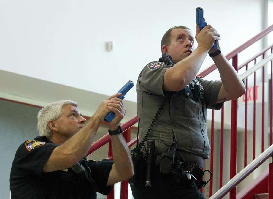Montgomery County law enforcement clear a stairwell during an active shooter training at Splendora High School on Wednesday, July 25, 2018, in Splendora. The Splendora ISD police department hosted dozens of Montgomery County law enforcement agencies to train for an active shooting situation. Photo: Jason Fochtman, Staff Photographer / Houston Chronicle / © 2018 Houston Chronicle