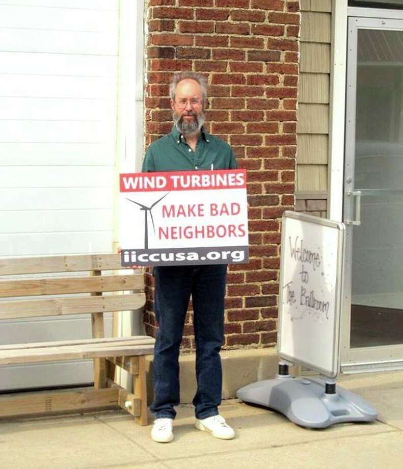 Robert McLean, chairman of the Huron County Planning Commission, is shown at an anti-wind demonstration outside of the Pasta House in Kinde. The picketing occurred a few years ago, before McLean was appointed to the planning commission. (Submitted Photo)