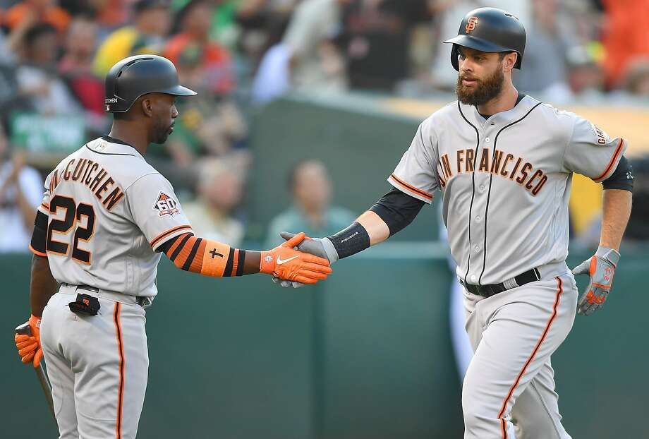 OAKLAND, CA - JULY 21:  Brandon Belt #9 of the San Francisco Giants is congratulated by Andrew McCutchen #22 after Belt hit a solo home run against the Oakland Athletics in the top of the fourth inning at the Oakland Alameda Coliseum on July 21, 2018 in Oakland, California. Photo: Thearon W. Henderson / Getty Images