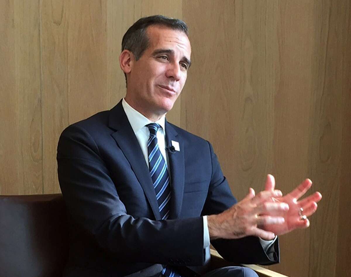 FILE - Eric Garcetti, mayor of Los Angeles, speaks during an interview at a hotel in Tokyo in this July 25, 2018 file photo.