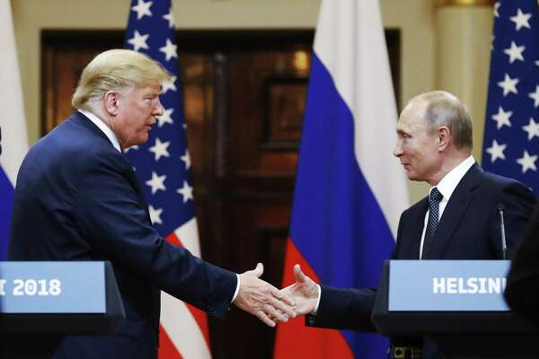 U.S. President Donald Trump shakes hand with Russian President Vladimir Putin at the end of the press conference after their meeting at the Presidential Palace in Helsinki, Finland.