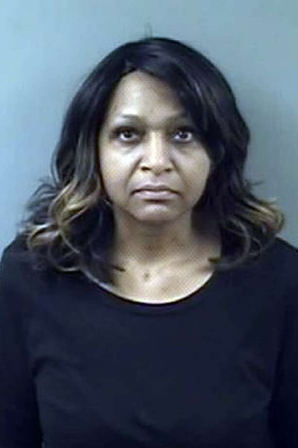 Kimberly Brown, a 10-year employee of the Department of Motor Vehicle, was charged with first-degree larceny and first-degree forgery. The DMV claims she stole $80,000 from the agency. Photo: Contributed Photo / Contributed Photo / Connecticut Post Contributed