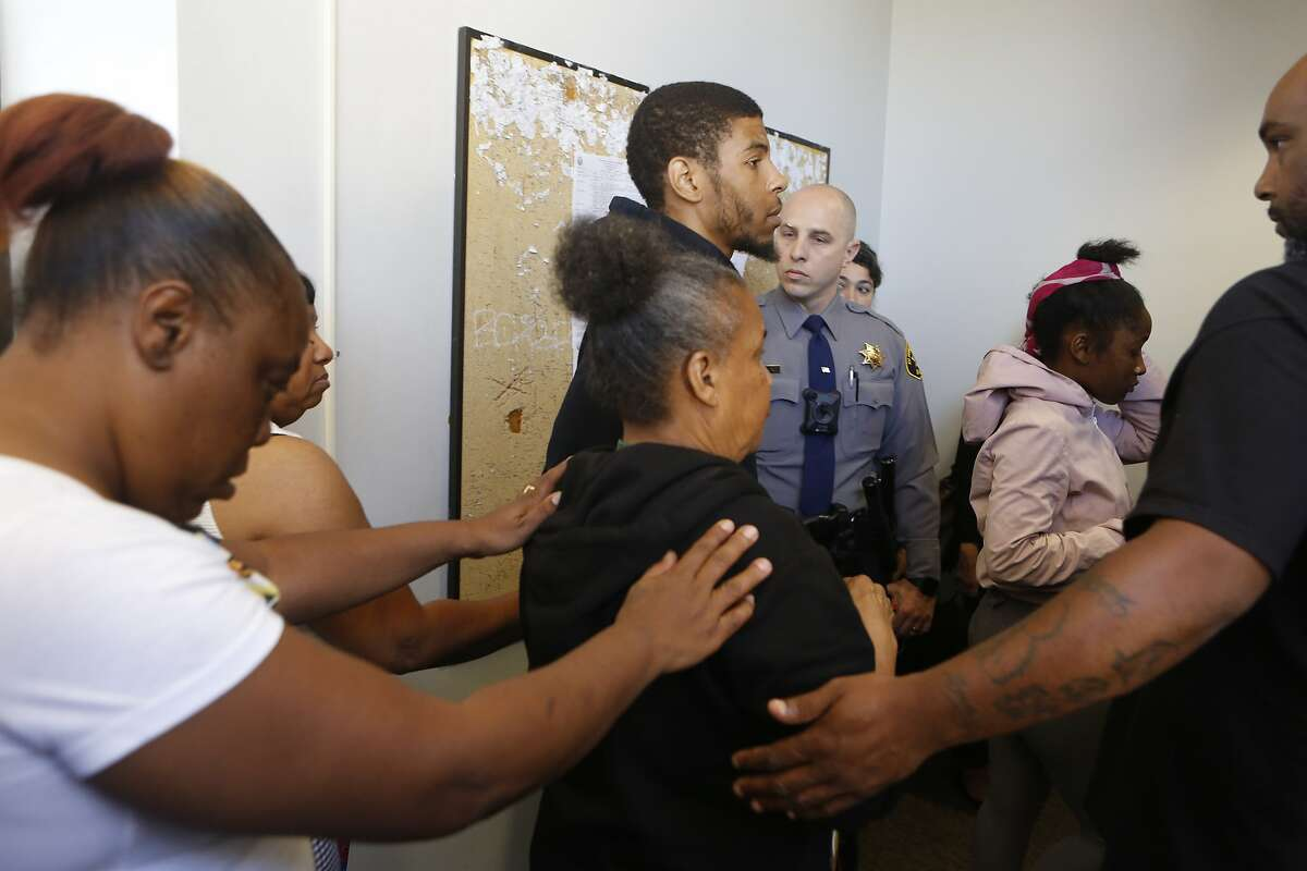 Family members of the late Nia Wilson, 18, enter a courtroom at the Wiley W. Manuel Courthouse for the arraignment of John Lee Cowell, on Wednesday, July 25, 2018 in Oakland, Calif. Cowell is accused of the double stabbing of Nia at the MacArthur BART station on Sunday night.