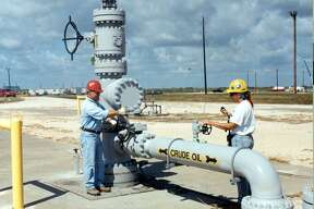 Workers test a wellhead valve at the U.S. Strategic Petroleum Reserve's Bryan Mound facility in Texas in this undated Department of Energy photo. Created in 1975, the Strategic Petroleum Reserve is held in salt caverns along the Gulf Coast of Texas and Louisiana and can hold up to 700 million barrels of oil. Source: U.S. Department of Energy/via Bloomberg News