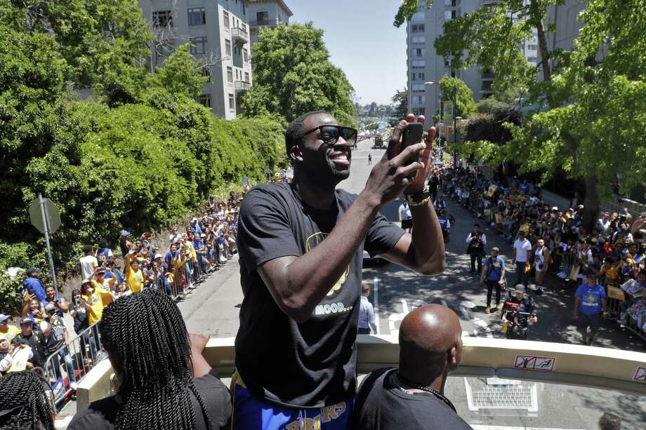 Draymond Green takes a photo of fans during the Golden State Warriors NBA Championship parade in Oakland, Calif., on Tuesday, June 12, 2018. Photo: Carlos Avila Gonzalez / The Chronicle / ONLINE_YES