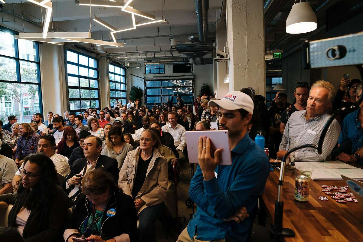 Supporters and members of the SoMa, Tenderloin, Mission Bay and Treasure Island neighborhoods listen in during the District 6 Supervisor debate featuring Sonja Trauss, Matt Haney, and Christine Johnson at the Cloudflare in San Francisco, Calif., Tuesday, July 24, 2018.