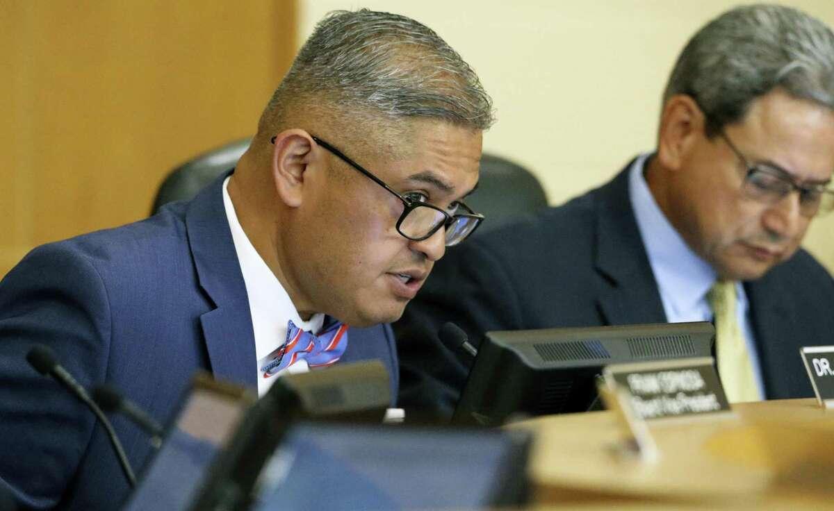 Edgewood ISD's board welcomed new superintendent Eduardo Hernandez, left, in 2018.