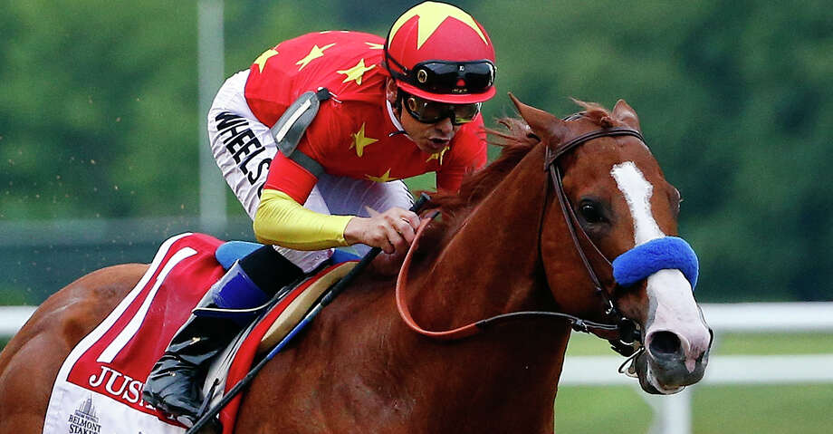 FILE - In this June 9, 2018, file photo, Justify (1), with jockey Mike Smith up, crosses the finish line to win the 150th running of the Belmont Stakes horse race and the Triple Crown in Elmont, N.Y. The undefeated Triple Crown winner has been retired from racing because of fluid in his left front ankle, trainer Bob Baffert and Justify's owners announced Wednesday, July 25, 2018. They cited caution over the horse's ankle making it impossible to tell if he'd be able to race by the fall.  (AP Photo/Peter Morgan, File Photo: Peter Morgan/Associated Press / Copyright 2018 The Associated Press. All rights reserved.