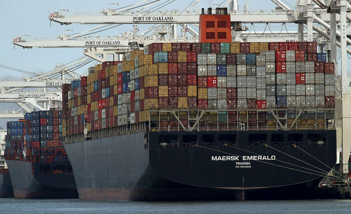 """The container ship Maersk Emerald is unloaded at the Port of Oakland Thursday, July 12, 2018, in Oakland, Calif. U.S. President Donald Trump is offering assurances that the United States will """"ultimately"""" work out a """"pretty nasty trade battle"""" with China. (AP Photo/Ben Margot)"""