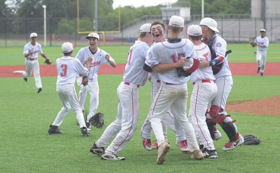 The Norwalk Revolution Babe Ruth 14-year-old All-Stars celebrate their win over Keene (N.H.) in the championship game of the New Englnad tournament at Brien McMahon High School's Pride Field in Norwalk. Photo: John Nash / Hearst Connecticut Media