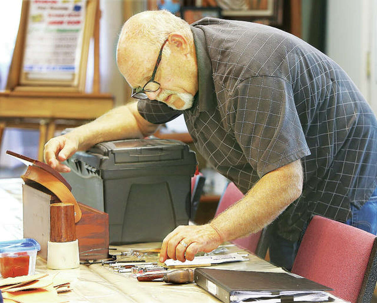 Leatherwork artist Terry Diveley prepares his tools before teaching a leather tooling and painting class this week in Wood River at Von Dell Gallery, 102 E. Ferguson Ave., where he leases a studio. He also teaches a leather tooling class at the gallery.