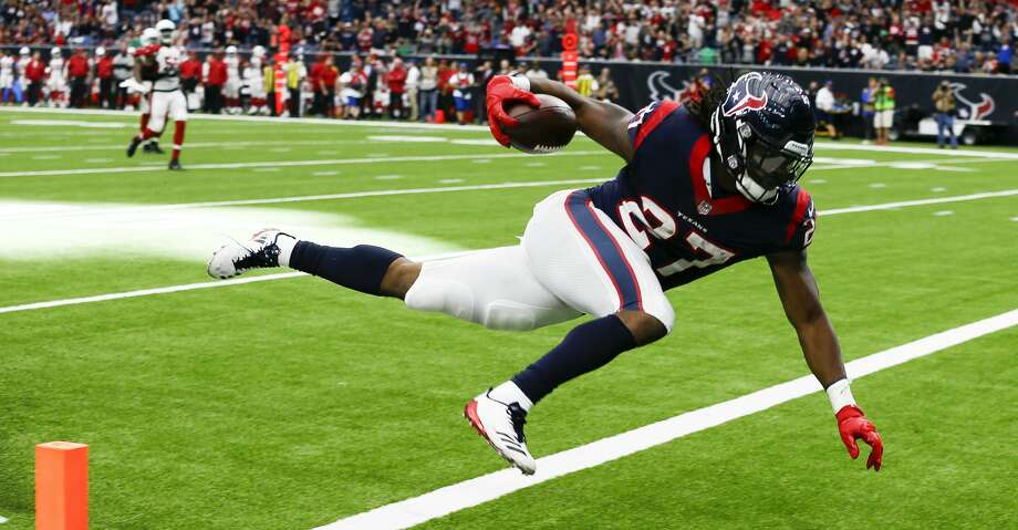 HOUSTON, TX - NOVEMBER 19:  D'Onta Foreman #27 of the Houston Texans runs 34 yards for a touchdown in the fourth quarter against the Arizona Cardinals at NRG Stadium on November 19, 2017 in Houston, Texas. Foreman was injured on the play and was taken off on a cart.  (Photo by Bob Levey/Getty Images) Photo: Bob Levey/Getty Images