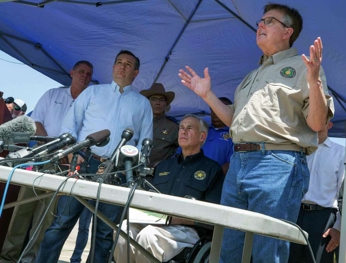 Lt. Governor Dan Patrick, at right, speaks at a press conference in the wake the mass shooting at Santa Fe High School on Friday, May 18, 2018. At left are Texas Gov. Greg Abbott and Sen. Ted Cruz. (Stuart Villanueva/The Galveston County Daily News via AP)