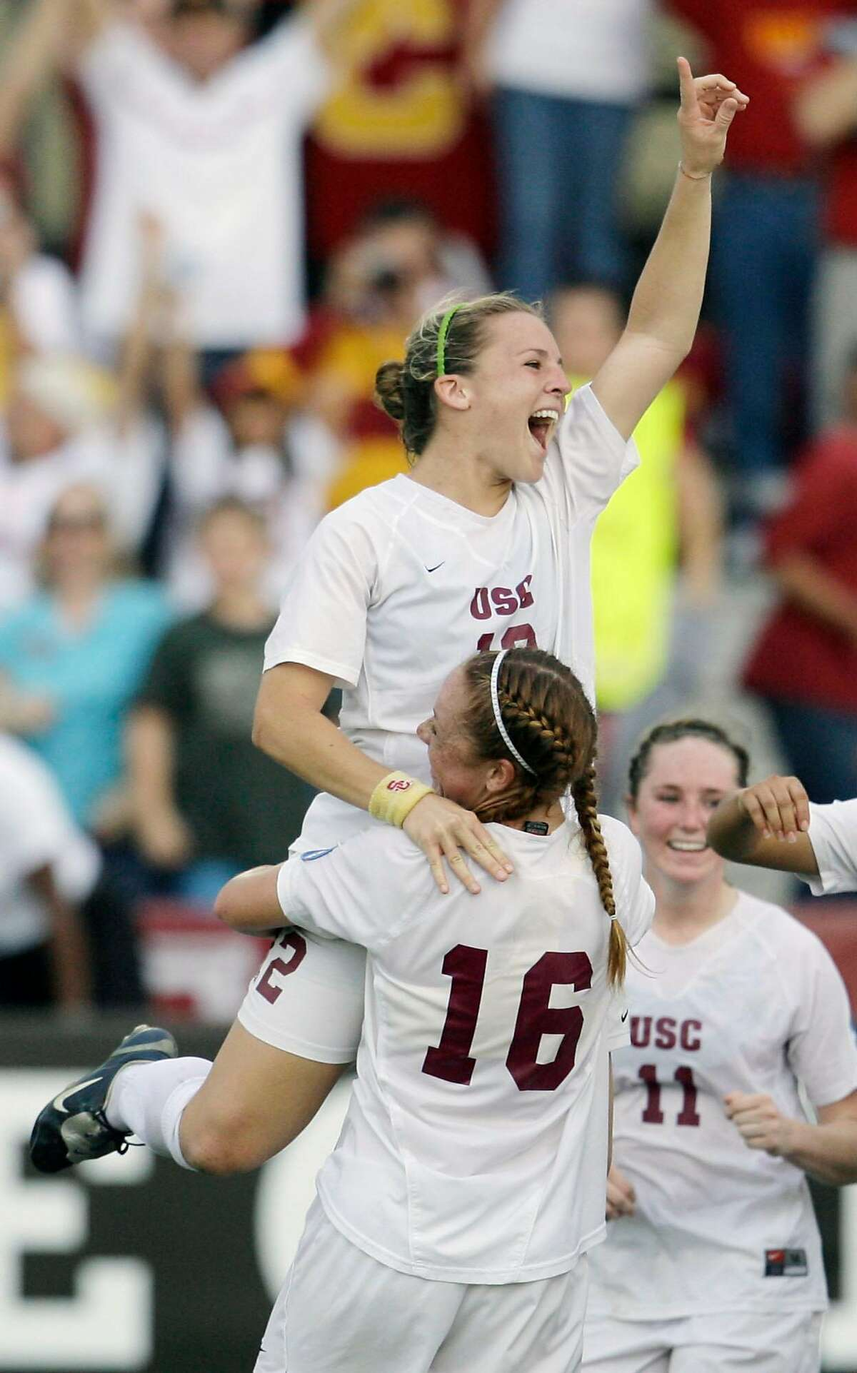 Southern California forward Amy Rodriguez (12) celebrates with teammate Ashley Nick (16) after Southern California defeated Florida State, 2-0, in the NCAA Women's College Cup championship soccer match, Sunday, Dec. 9, 2007, in College Station, Texas. (AP Photo/Matt Slocum)
