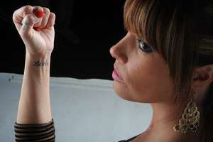 Hollie Toups, 32, said she got 'Let it be' tattooed on her arm after finding her picture on a revenge porn website. Photo taken Friday, January 18, 2013 Guiseppe Barranco/The Enterprise