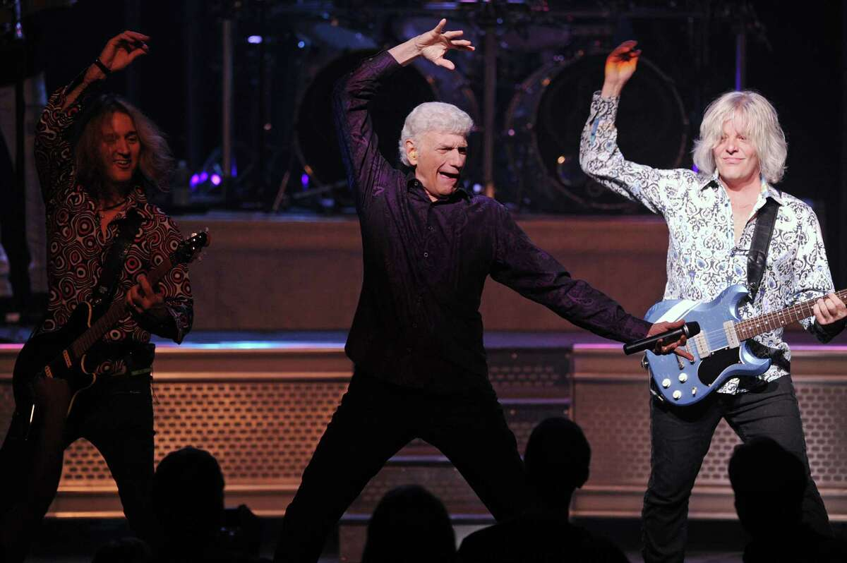 From right, guitarist Jimmy Leahey, lead man Dennis DeYoung and guitarist August Zadra rock out on stage during Wednesday Nite Live inside the Palace Theatre on Atlantic St. in downtown Stamford, Conn. on Wednesday, July 25, 2018.