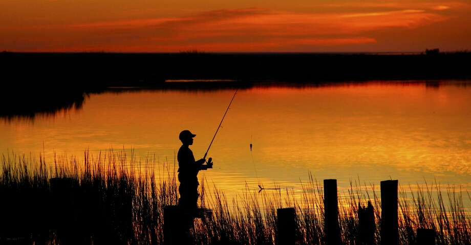 Texas anglers can beat the worst of summer's brutal and even dangerous heat - and, in many cases, improve their prospects for encountering active, catchable fish - by concentrating their fishing around dawn, dusk or during the night. Photo: Shannon Tompkins/Houston Chronicle