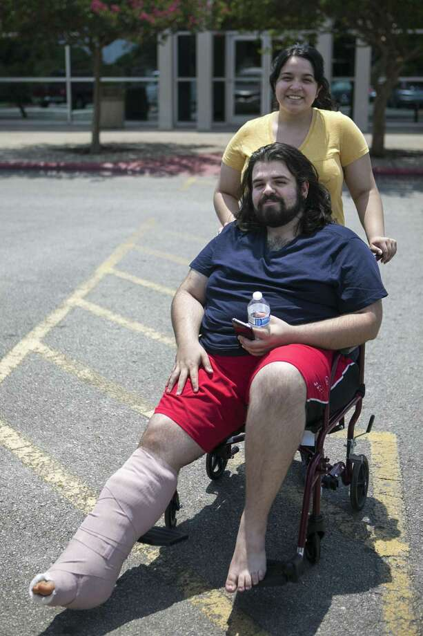 Benjamin Muñoz and Abril Cardenas got engaged in the emergency room while he was awaiting surgergy for injuries he sustained in a deadly fire June 20 at their apartment at Iconic Village. They came to the San Marcos Activity Center on July 25, 2018, to get assistance. Photo: Josie Norris /San Antonio Express-News / © San Antonio Express-News