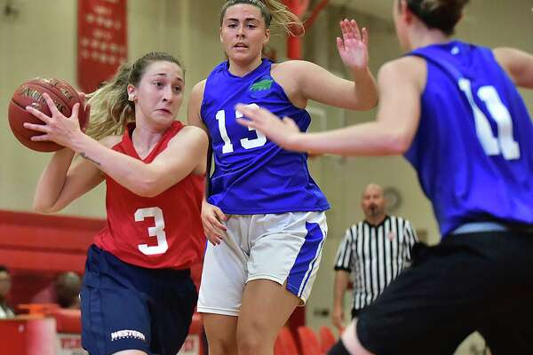 Action from the collegiate division of the New Haven Summer Women's Basketball League, Wednesday, July 25, 2018, at Wilbur Cross High School in New Haven.