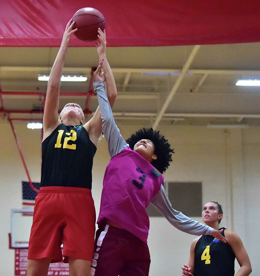 Action from the collegiate division of the New Haven Summer Women's Basketball League, Wednesday, July 25, 2018, at Wilbur Cross High School in New Haven. Photo: Catherine Avalone, Hearst Connecticut Media / New Haven Register