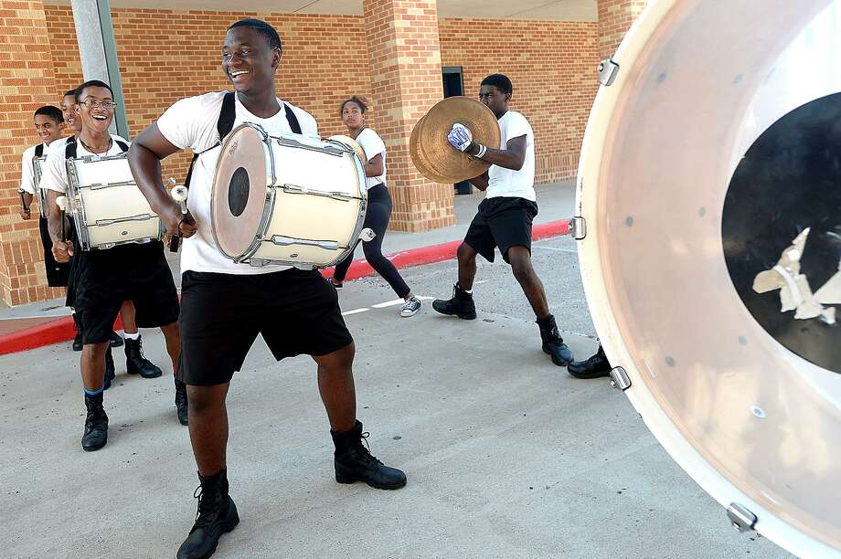 Members of the drum line and cymbalists add dance moves to their beat as Beaumont United HIgh School's marching band practice. Band rehearsals started this week and will continue for the next three weeks as the members come together, learning a new school song and setting the tone for their style and school spirit. Wednesday, July 25, 2018 Kim Brent/The Enterprise Photo: Kim Brent / The Enterprise / BEN