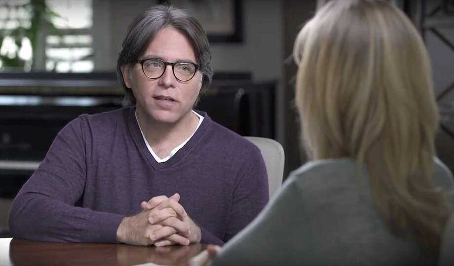 """NXIVM leader Keith Raniere and Allison Mack appear in a group of videos titled """"Keith Raniere Conversations,""""  that were published on YouTube on April 9, 2017. (Keith Raniere Conversations/YouTube)"""