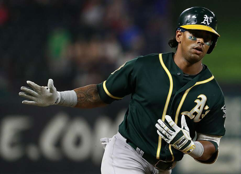 ARLINGTON, TX - JULY 25:  Khris Davis #2 of the Oakland Athletics celebrates after hitting a three-run homerun in the seventh inning against the Texas Rangers at Globe Life Park in Arlington on July 25, 2018 in Arlington, Texas.  (Photo by Ronald Martinez/Getty Images) Photo: Ronald Martinez / Getty Images