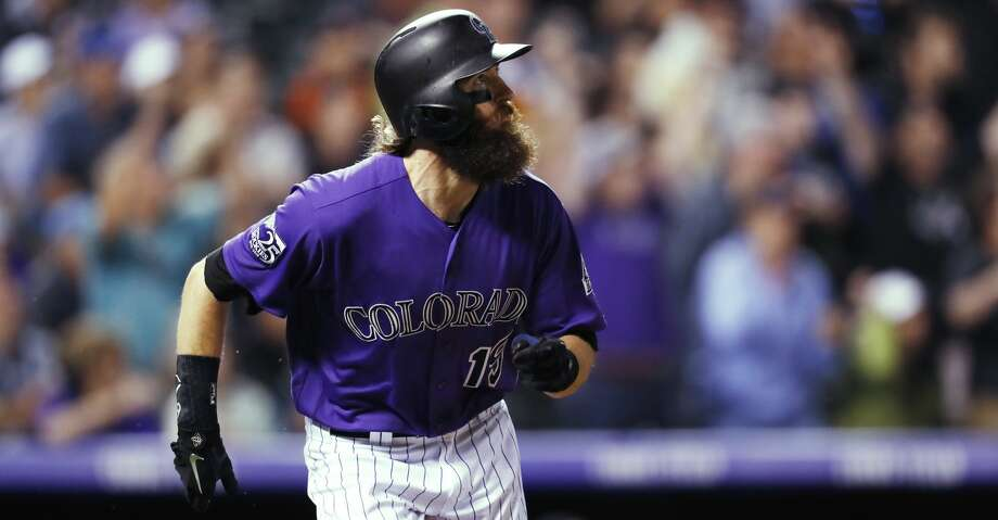 Colorado Rockies' Charlie Blackmon watches his walk-off solo home run off Houston Astros relief pitcher Collin McHugh during a baseball game Wednesday, July 25, 2018, in Denver. The Rockies won 3-2. (AP Photo/David Zalubowski) Photo: David Zalubowski/Associated Press