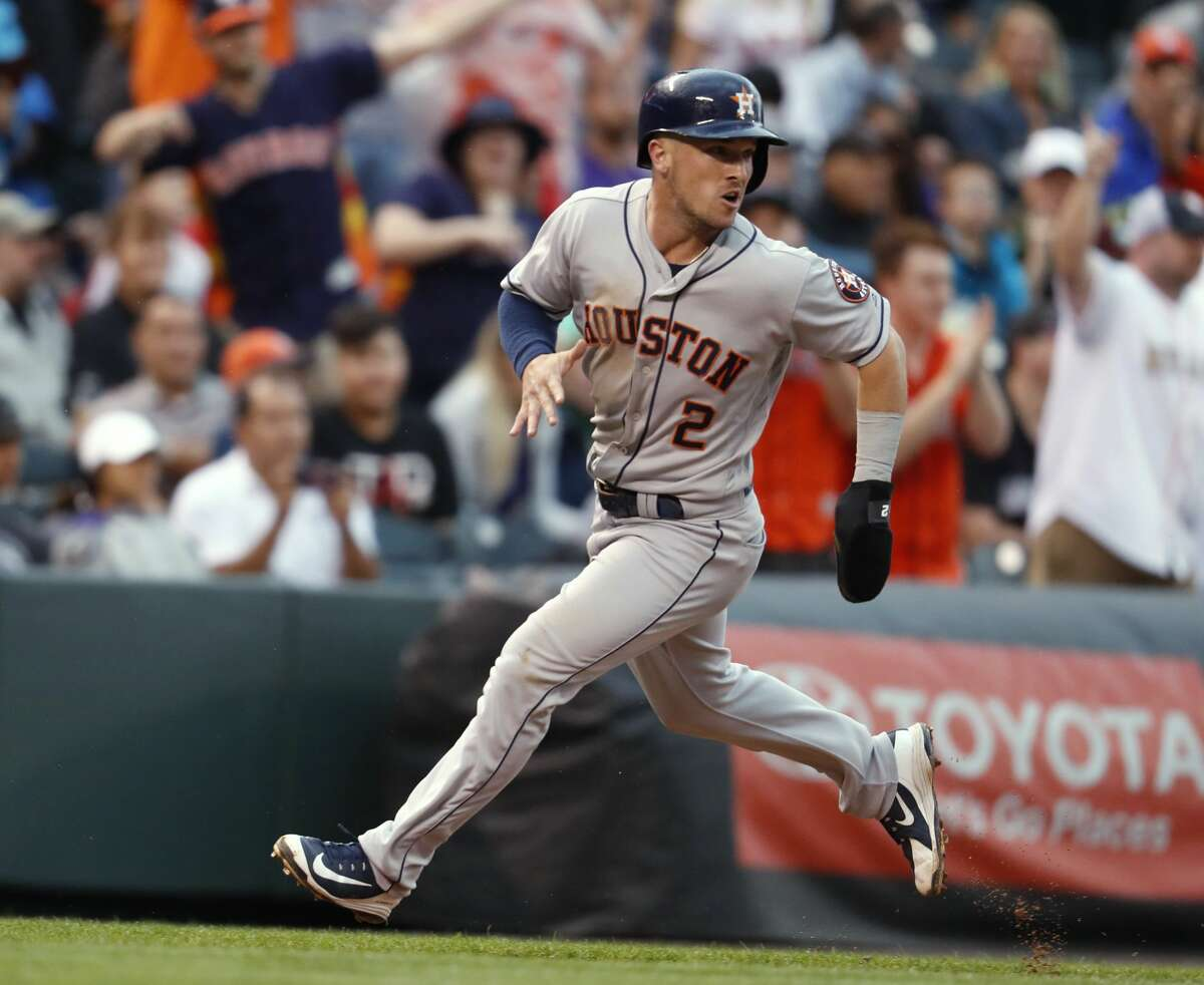 Houston Astros' Alex Bregman rounds third base on the way to scoring on a double by Jose Altuve off Colorado Rockies starting pitcher Jon Gray during the fourth inning of a baseball game Wednesday, July 25, 2018, in Denver. (AP Photo/David Zalubowski)
