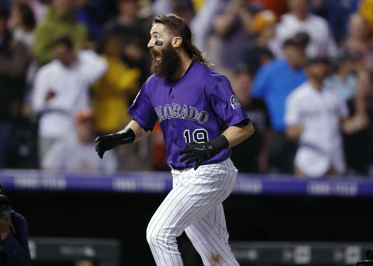 Colorado Rockies' Charlie Blackmon reacts as he circles the bases after hitting a walk-off solo home run off Houston Astros relief pitcher Collin McHugh in a baseball game Wednesday, July 25, 2018, in Denver. The Rockies won 3-2. (AP Photo/David Zalubowski)