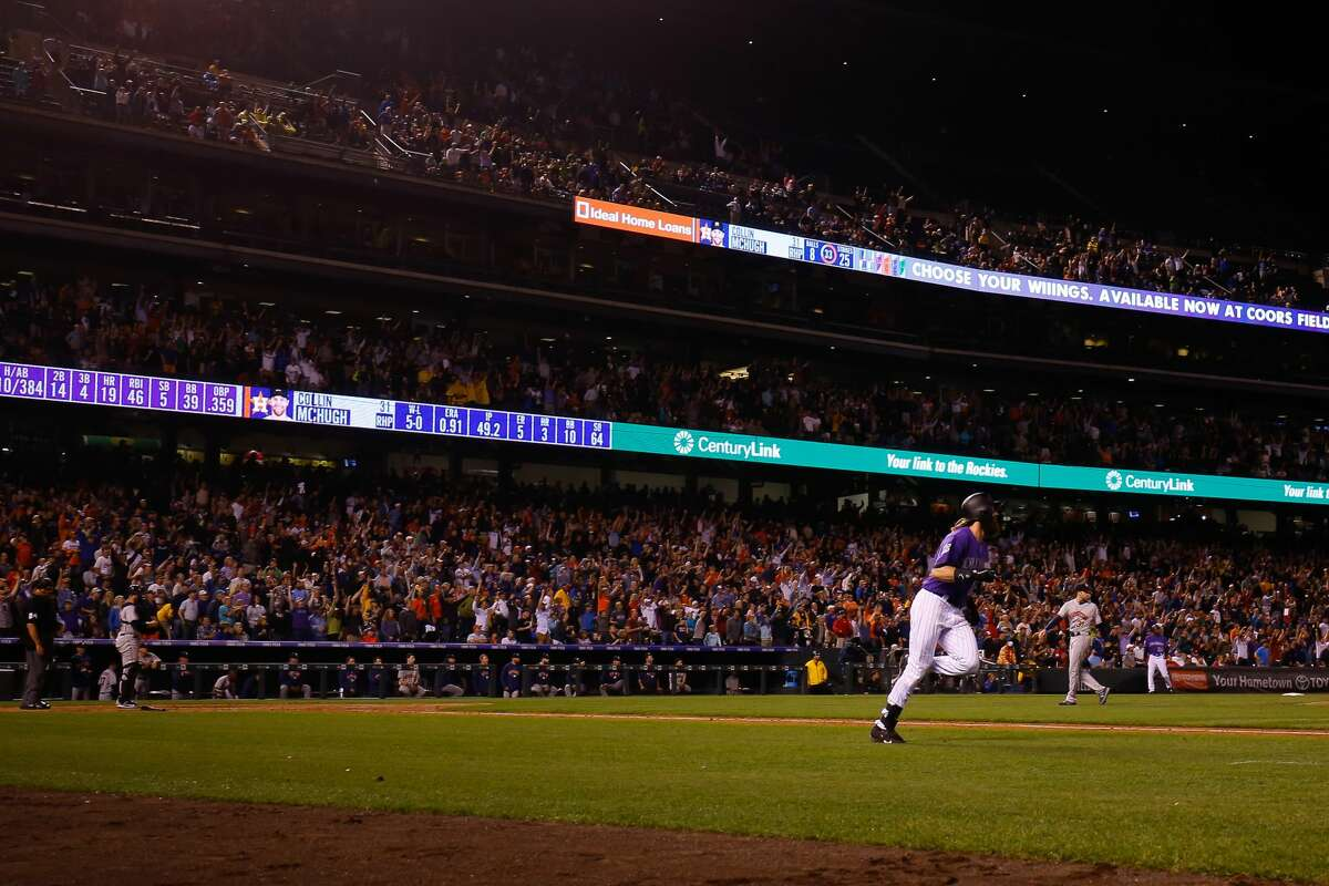 DENVER, CO - JULY 25: Charlie Blackmon #19 of the Colorado Rockies watches his walk-off solo home run in the ninth inning against Collin McHugh #31 of the Houston Astros during interleague play at Coors Field on July 25, 2018 in Denver, Colorado. The Rockies defeated the Astros 3-2. (Photo by Justin Edmonds/Getty Images)