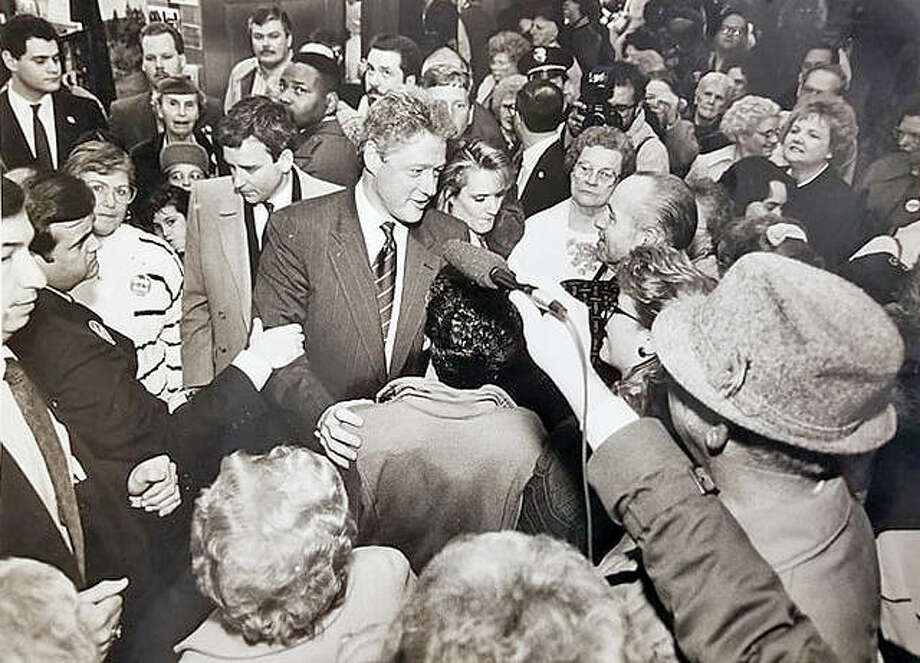 """It was a raucous scene when Democratic Presidential Candidate Bill Clinton showed up Saturday, March 14, 1992 at what was then the Alton Square Shopping Center. The Telegraph reported that 1,200 jammed the center to meet the POTUS-to-be, including 150 laid-off steelworkers. With lax security that would be extremely unlikely today, Clinton mingled through the mob, shaking hands and brushing shoulders. Clinton had been briefed on how jobs at Laclede Steel Co. had been lured to Indiana by way of state and federal tax incentives. Standing on a platform in front of J.C. Penney, he took questions from the crowd. """"Let's make this an old-fashioned town meeting in Alton. You fire away with questions, and I'l try to answer."""" … """"If I'm elected, there will be industry tax incentives to keep jobs from leaving Alton for Indiana."""" … """"I'm the new voice for the working people in this country. I'm bringing the White House back to the people in Alton, Belleville and Chicago."""" Photo:     John Badman 